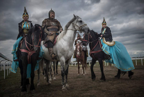 Kazakhs in traditional dress at the first Central Asian championship of kokpar, similar to polo, in Astana.